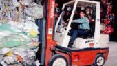 Sol Plastics employee sorts the raw material in the warehouse facility.