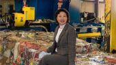 Emterra Group President Emmie Leung sits on a recycled bale at the Winnipeg recycling plant she's upgrading as part of the city's shift toward automated cart recycling.